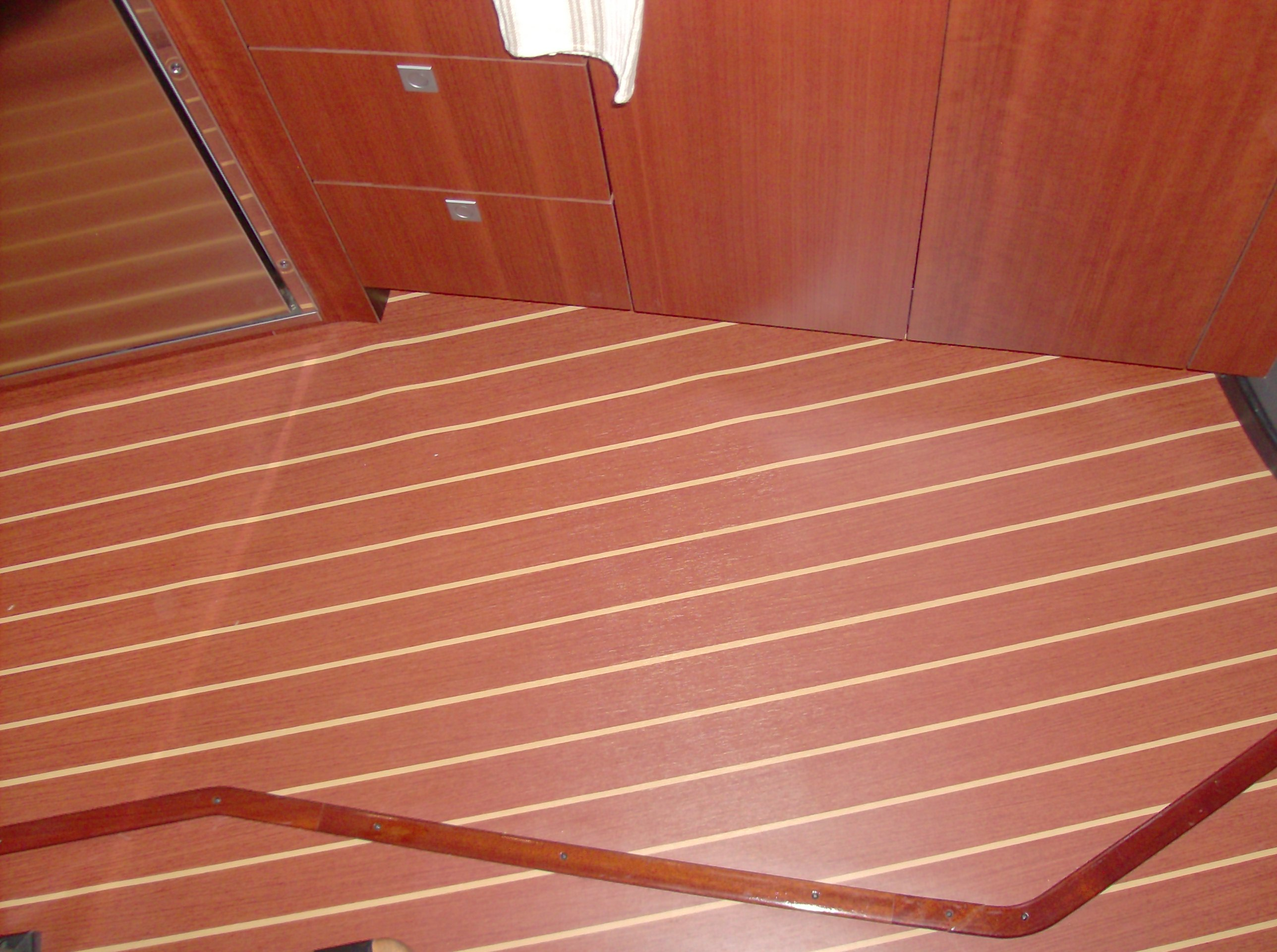 Services converta boat international for Laminate flooring services